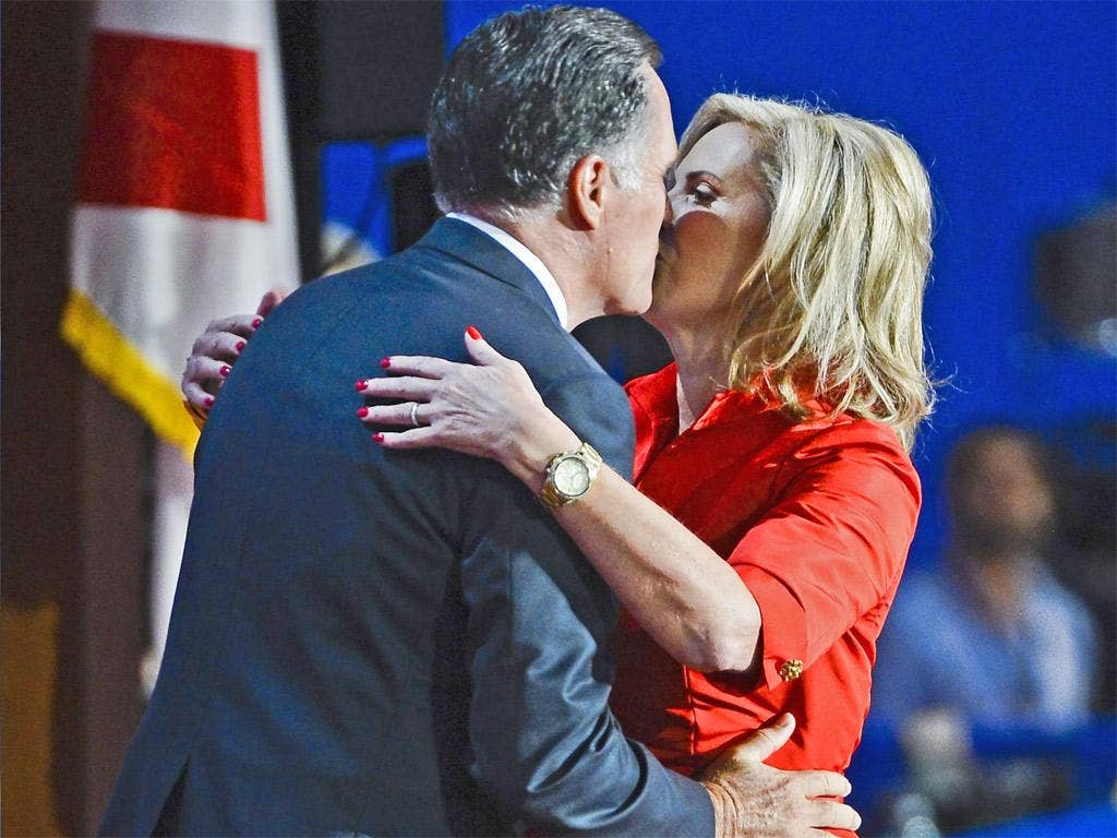 Ann Romney gets a kiss from husband and Republican Presidential Nominee Mitt Romney after her speech