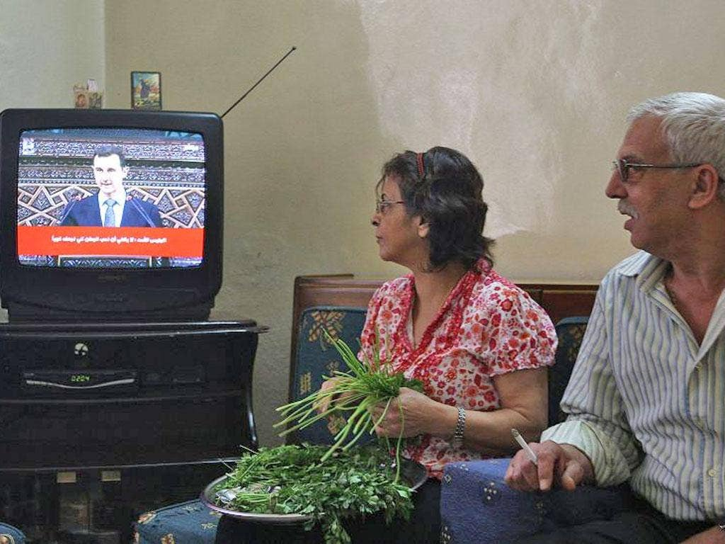 Minister Omran Zoubi controls how Syrians see their President and how the civil war is portrayed