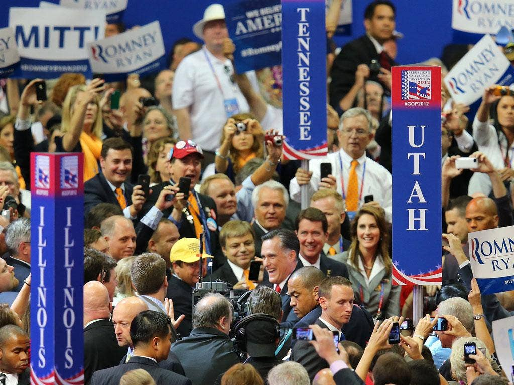 Mitt Romney is surrounded by the Republican faithful in Tampa