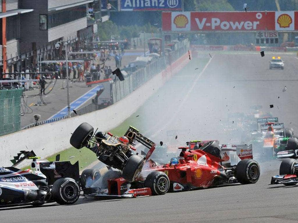 McLaren driver Lewis Hamilton was clipped byRomain Grosjeanas he attempted to cut across the Briton