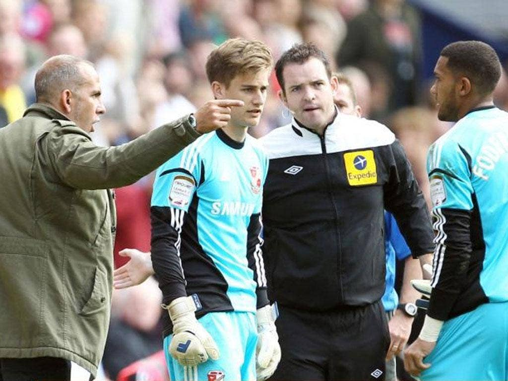 Paolo Di Canio substitutes Wes Foderingham (right) with Leigh Bedwell, provoking an angry reaction from the goalkeeper