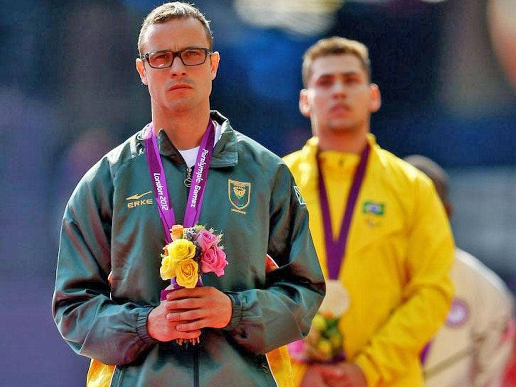 Oscar Pistorius (left) with his conqueror Oliveira at yesterday's medal ceremony