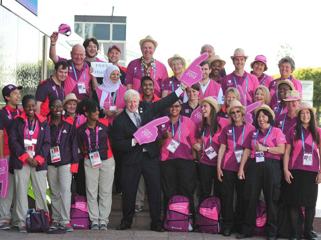 Boris Johnson celebrates a job well done with volunteering heroes yesterday