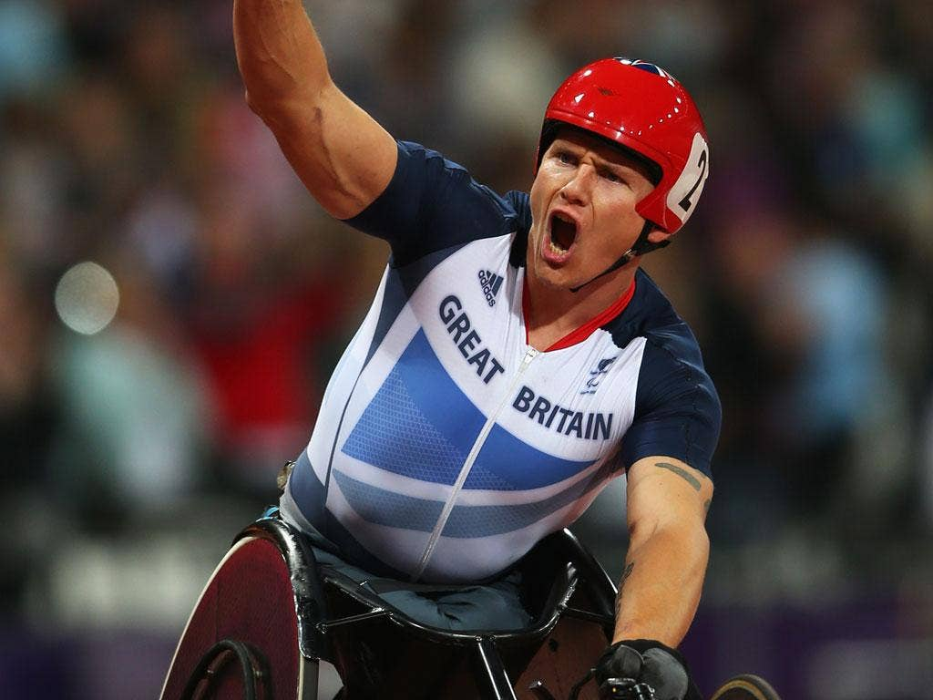 Big shout: David Weir wins gold in the T54 5,000m, and aims to add the marathon title today