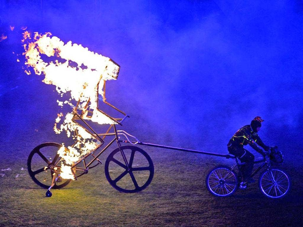 While the music set the crowd (or at least Coldplay lovers) alight, a flaming cyclist brought some real fire to proceedings