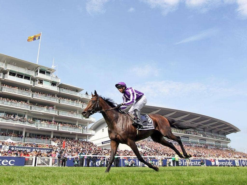Camelot, ridden by Joseph O'Brien, on his way to glory in the Derby