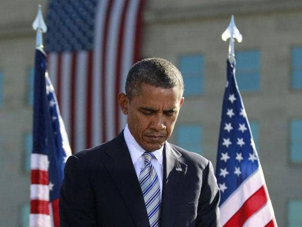 Barack Obama observes a moment of silence on the 11th anniversary of the 9/11 attacks