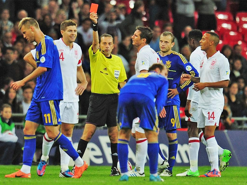 Steven Gerrard receives his red card after picking up a second yellow