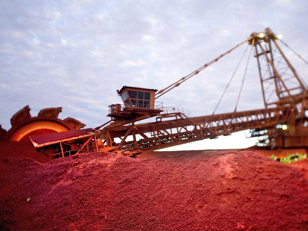 A reclaimer at work on a BHP Billiton iron ore stockpile at Port Hedland in Western Australia