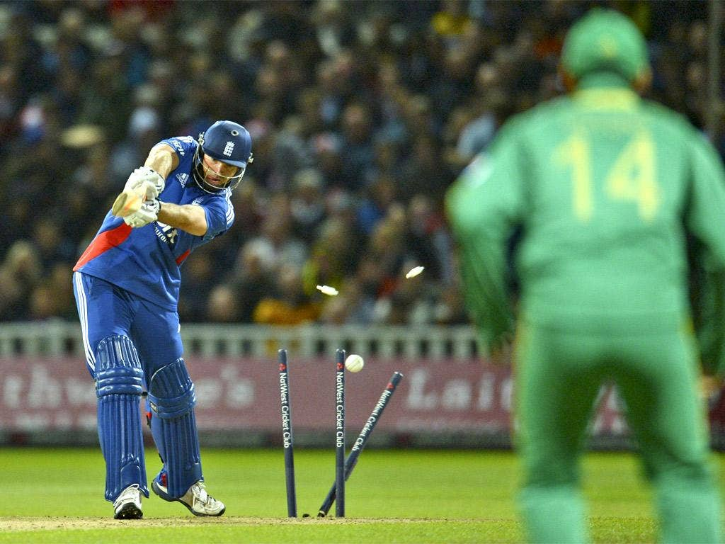 England's Michael Lumb is bowled for 5 runs