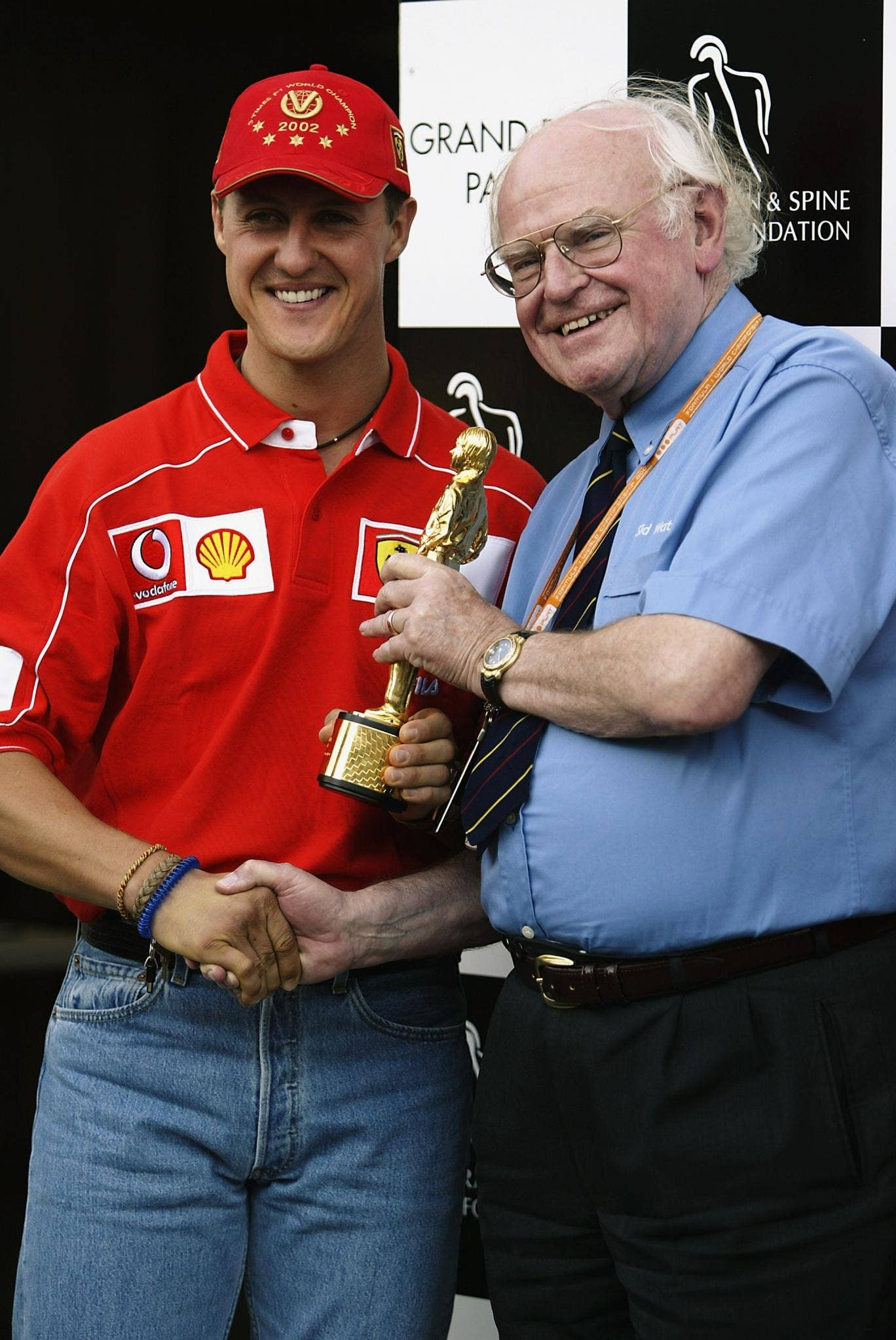 Sid Watkins (right) with former champion Michael Schumacher