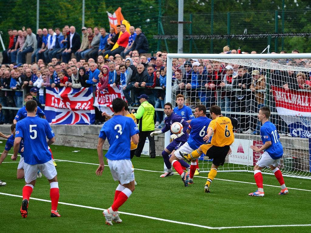 Blockade: Scott Chaplain of Annan is thwarted by Lee McCulloch and Neil Alexander of Rangers