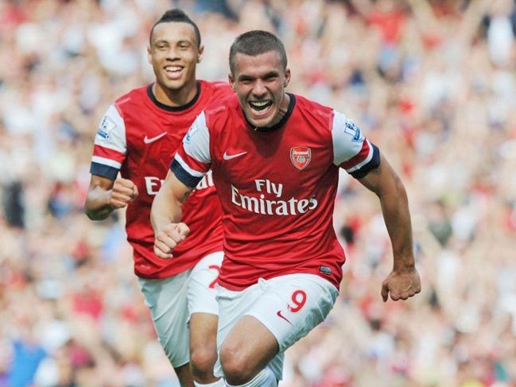 Lukas Podolski wheels away after scoring against Southampton