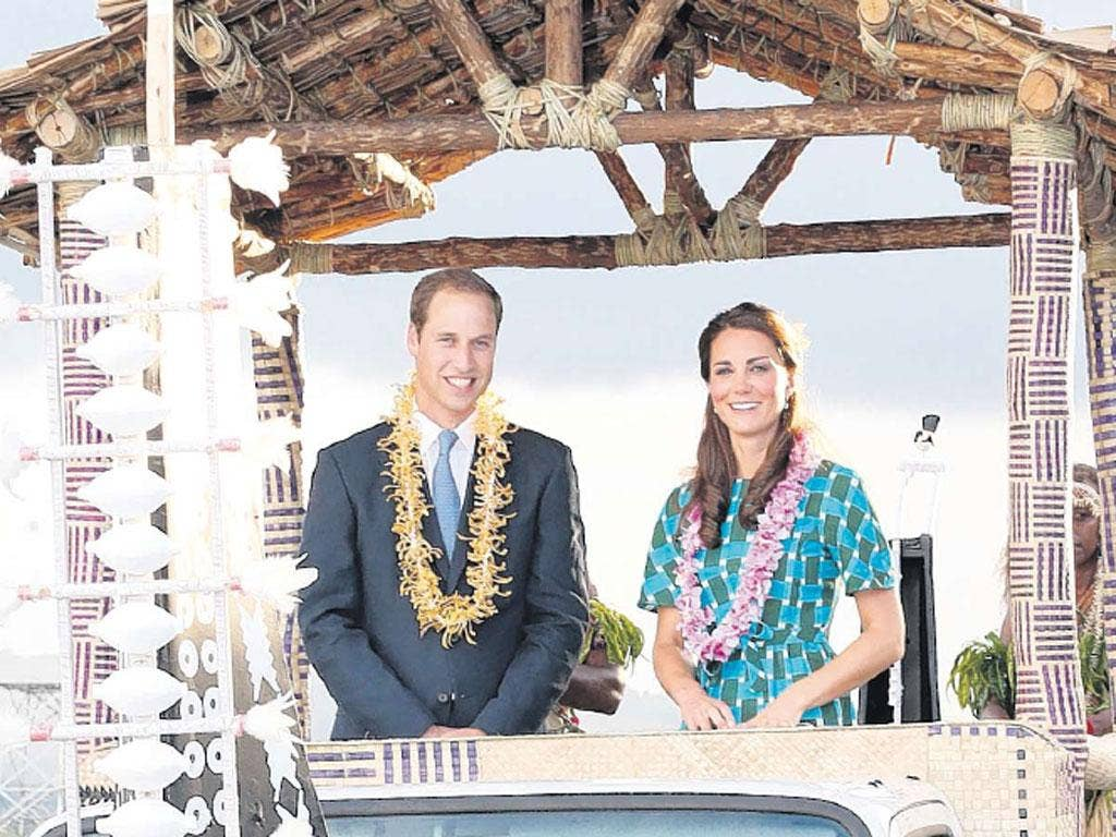 Prince William and Kate in the Solomon Islands yesterday. Legal action on their behalf will start today