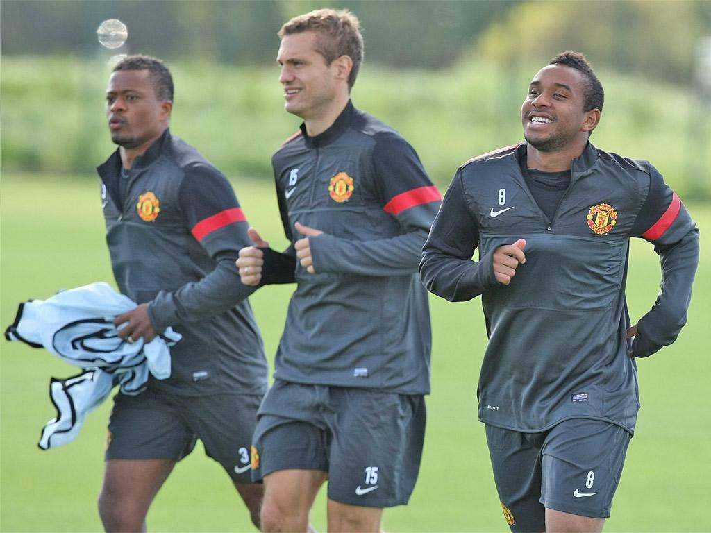 Nemanja Vidic (centre) is a key figure if United are to do well