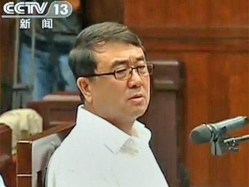 Former police chief Wang Lijun speaks to the court during his trial in Chengdu