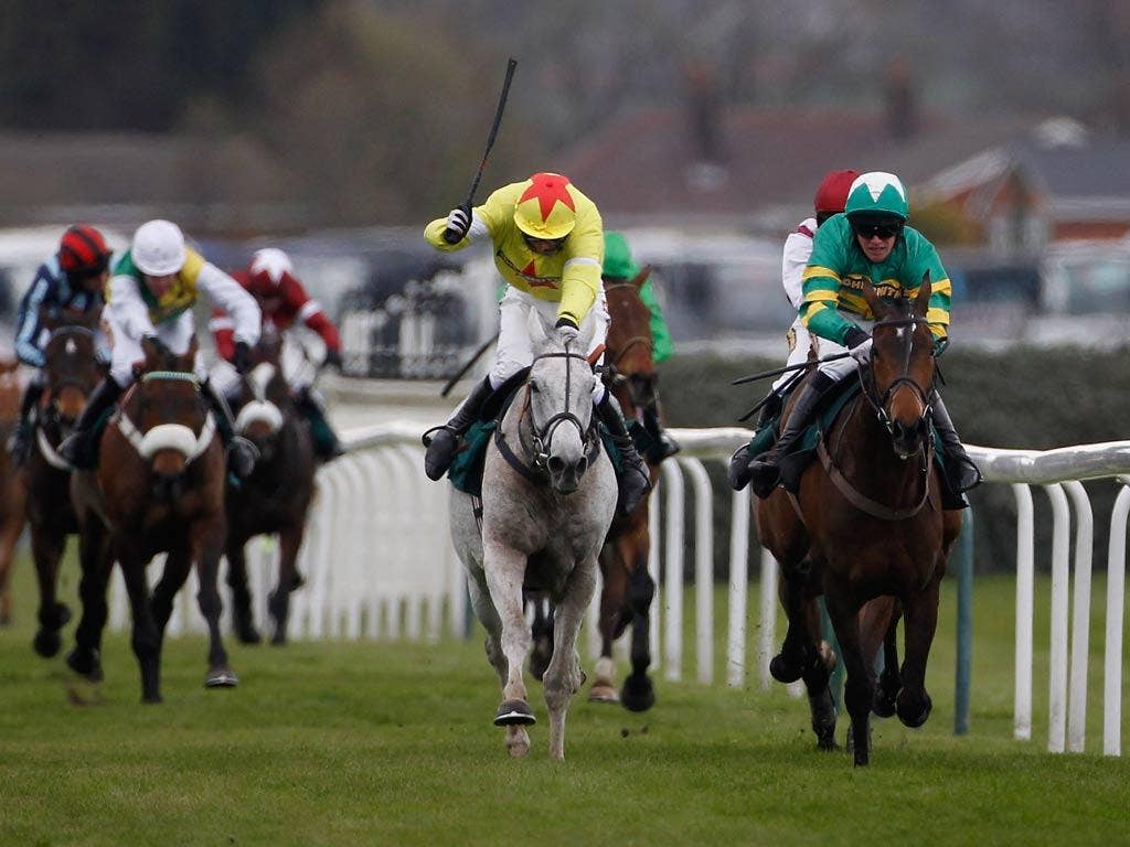 Daryl Jacob riding Neptune Collonges (grey horse) on their way to winning The John Smith's Grand National earlier this year