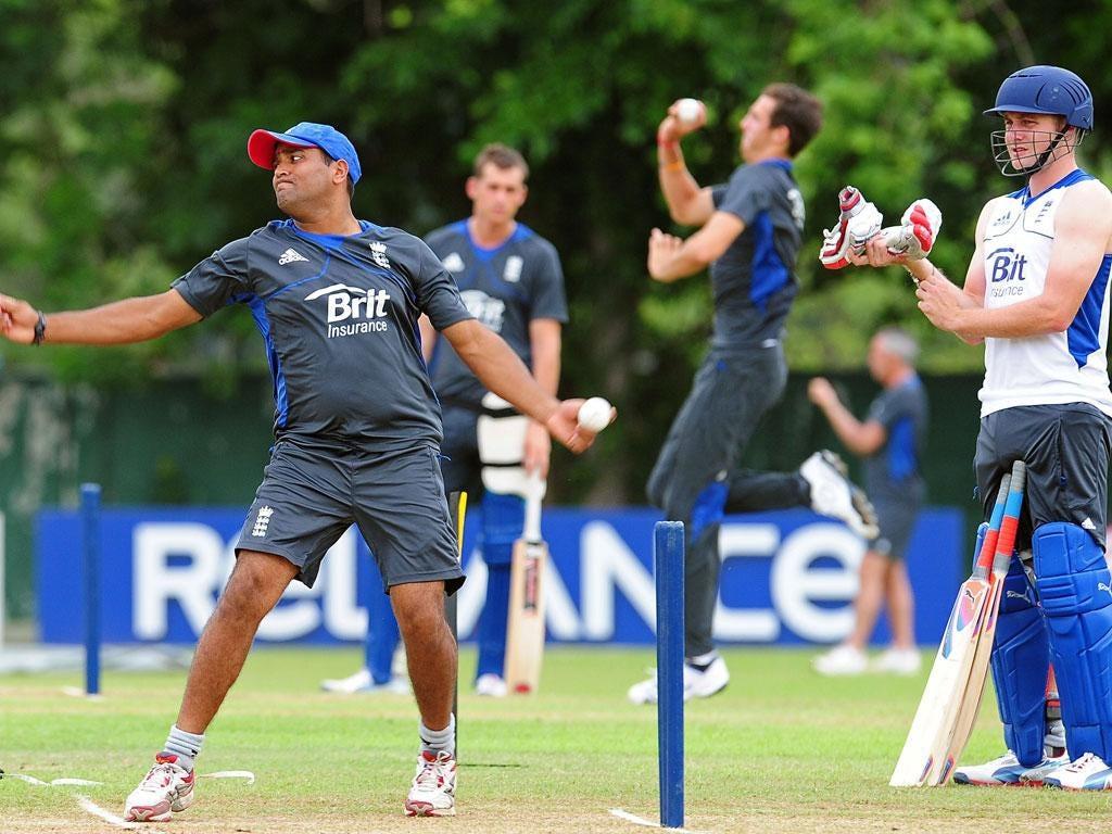Samit Patel (left) turns his arm during training yesterday