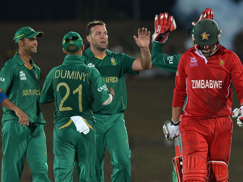 Jacques Kallis celebrates after he dismisses Zimbabwe cricketer Craig Ervine