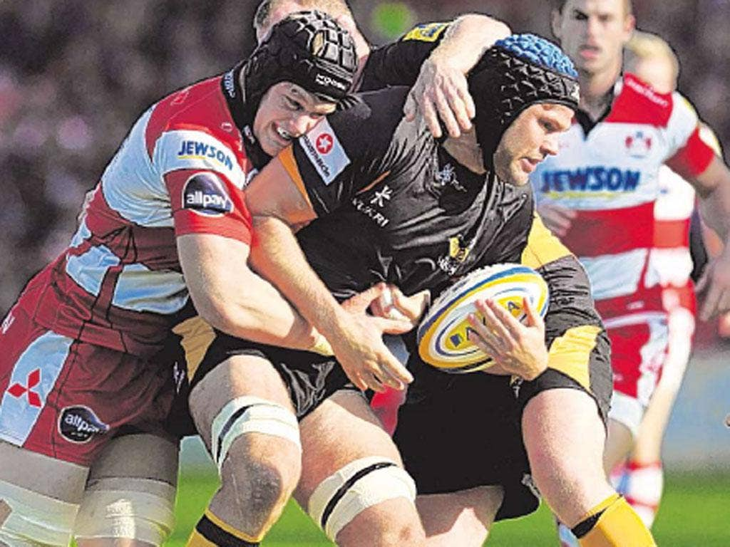 Tom Savage (left) puts in a hit on Wasps' Tom Palmer