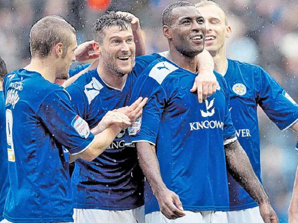 David Nugent (second left) celebrates his second goal against Hull yesterday