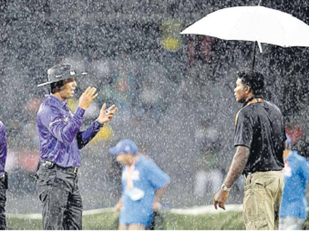 The umpires admit defeat and call off the match in the pouring rain of Colombo