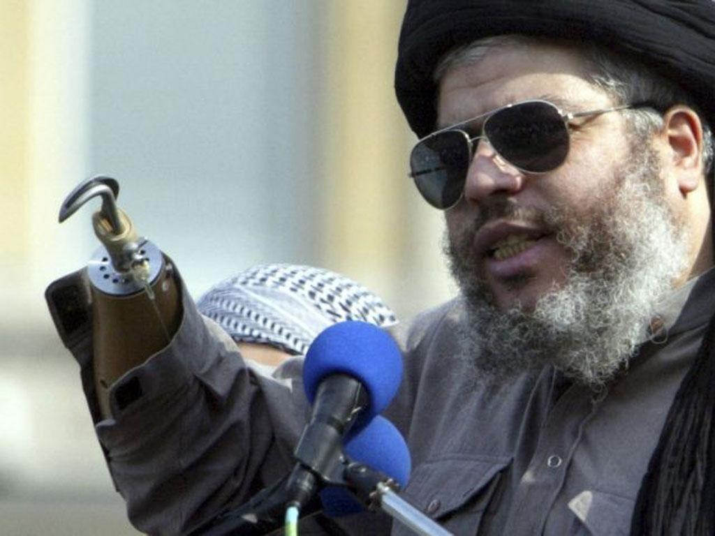 Muslim cleric, Abu Hamza al-Masri, is seen addressing the sixth annual rally for Islam in Trafalgar Square, London in this August 25, 2002