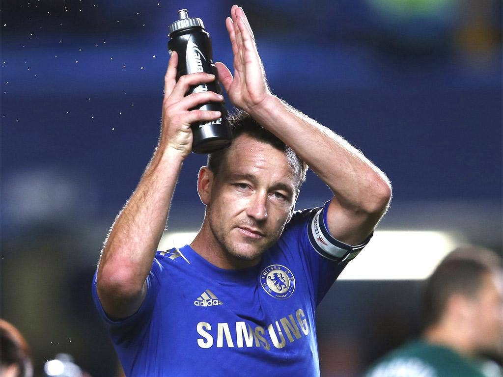 John Terry applauds the fans at Stamford Bridge last night