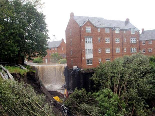 A block of flats in Newburn, Newcastle had to be evacuated after floods washed away its foundations