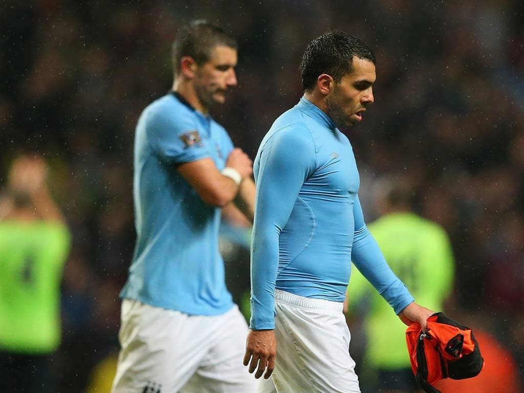 Manchester City striker Carlos Tevez leaves the field after defeat to Aston Villa