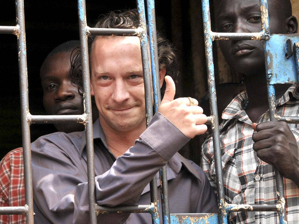 David Cecil in a Kampala court cell after his arrest earlier this month