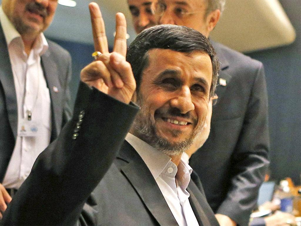 Mahmoud Ahmadinejad gestures prior to his address, in which he called for a new world order