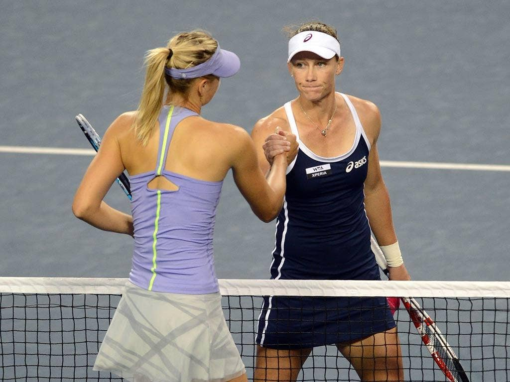 Samantha Stosur (R) of Australia is congratulated on her victory by Maria Sharapova