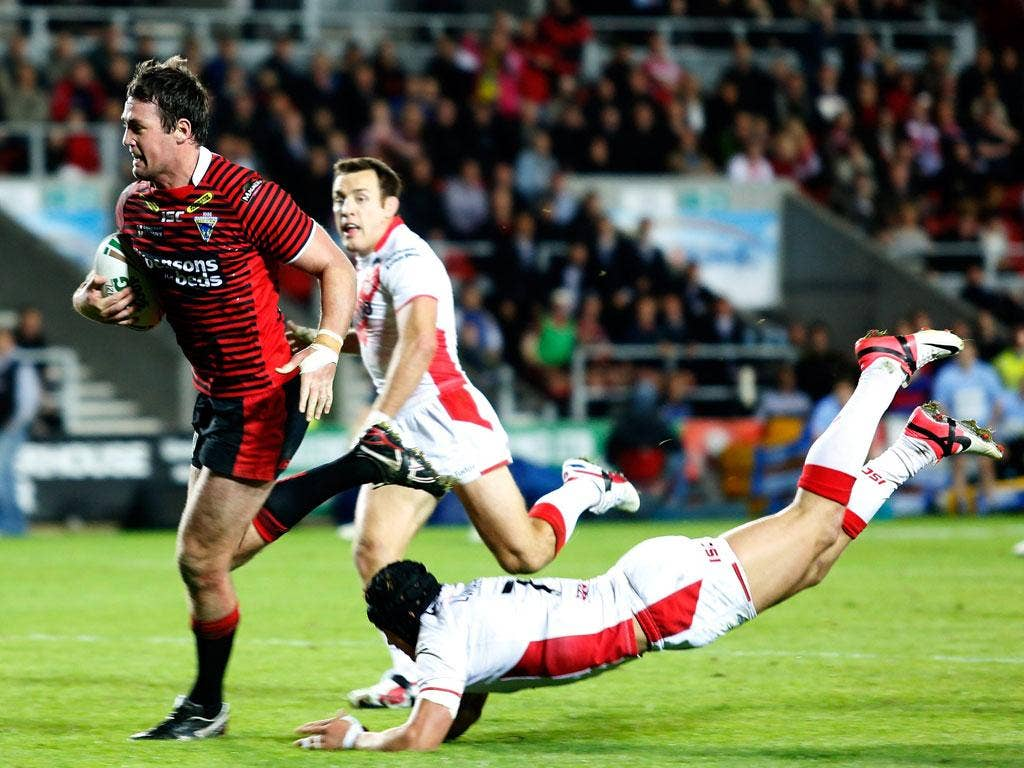 Pack leader: Trent Waterhouse scores during the Wolves' win last night