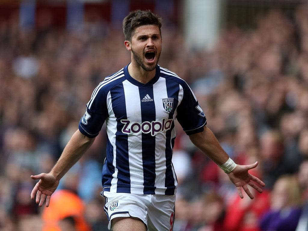 Shane Long of West Bromwich Albion celebrates scoring the first goal
