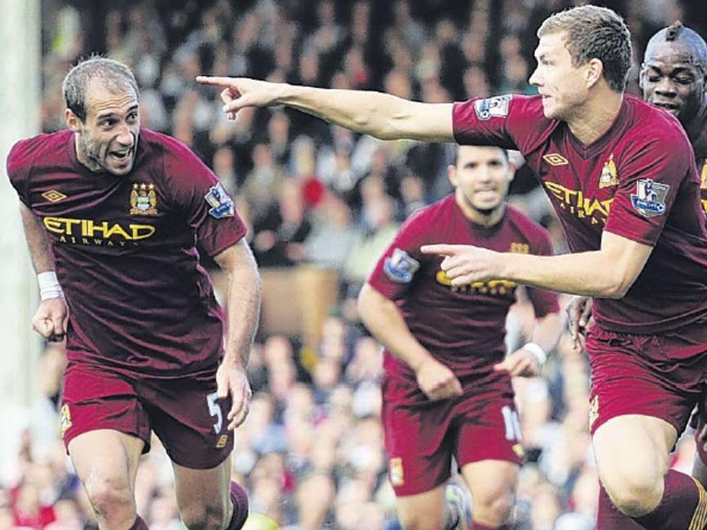 Edin Dzeko celebrates scoring City's late winner on Saturday