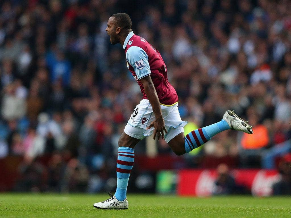 Darren Bent of Aston Villa celebrates after scoring the equalizing goal