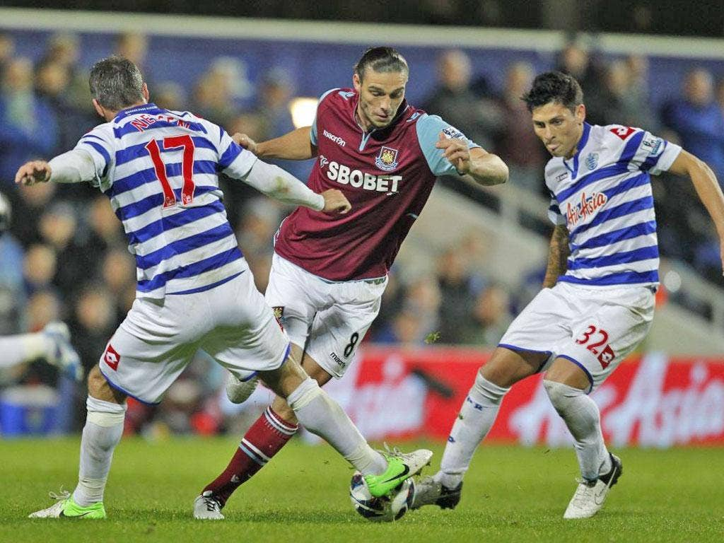 West Ham United's Andy Carroll (on loan from Liverpool) vies with Queens Park Rangers' Ryan Nelsen