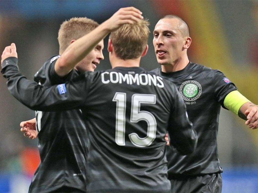 Celtic players celebrate a historic victory in Moscow