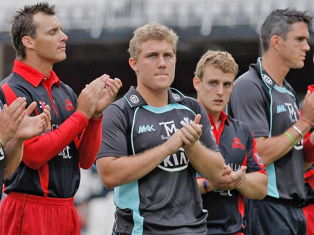 Rory Hamilton-Brown (second left) takes part in a tribute to Tom Maynard before a game between Surrey and Glamorgan