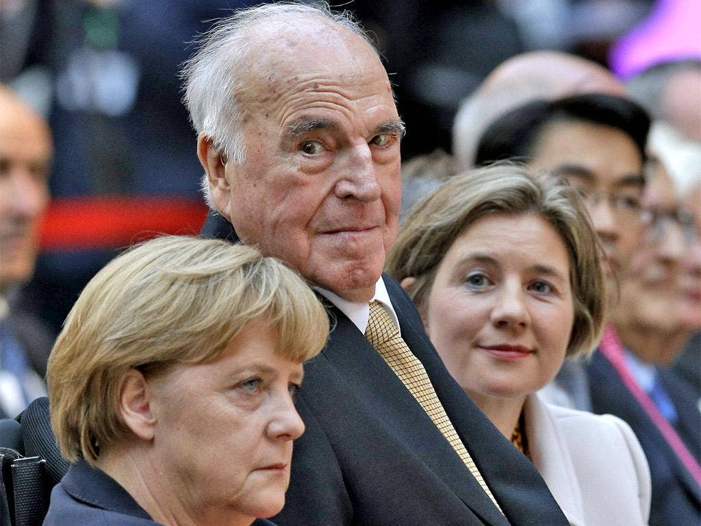 Helmut Kohl with his new wife Maike, and Angela Merkel at a reception in his honour