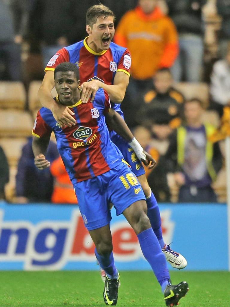 Wilfried Zaha celebrates his winner for Crystal Palace