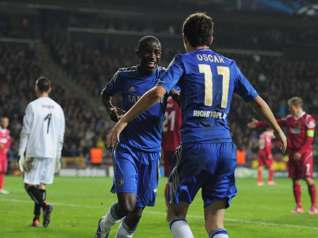 Ramires of Chelsea celebrates with team-mate Oscar after scoring during the UEFA Champions League Group E match against FC Nordsjaelland