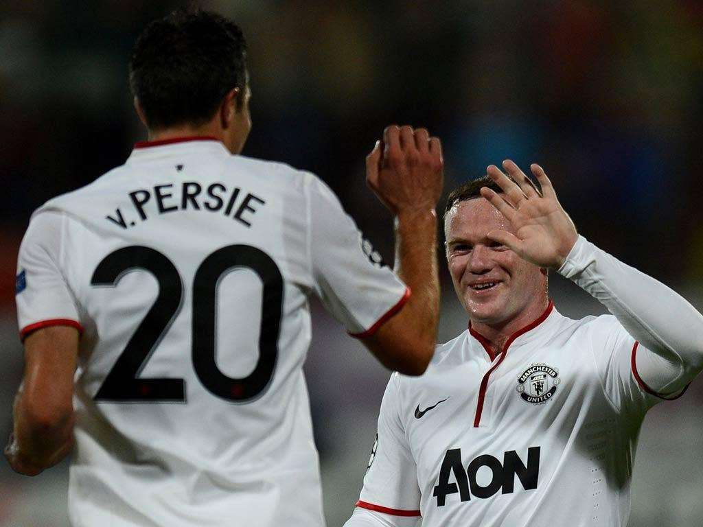 Wayne Rooney provided both assists for Robin van Persie in the Champions League match against Cluj