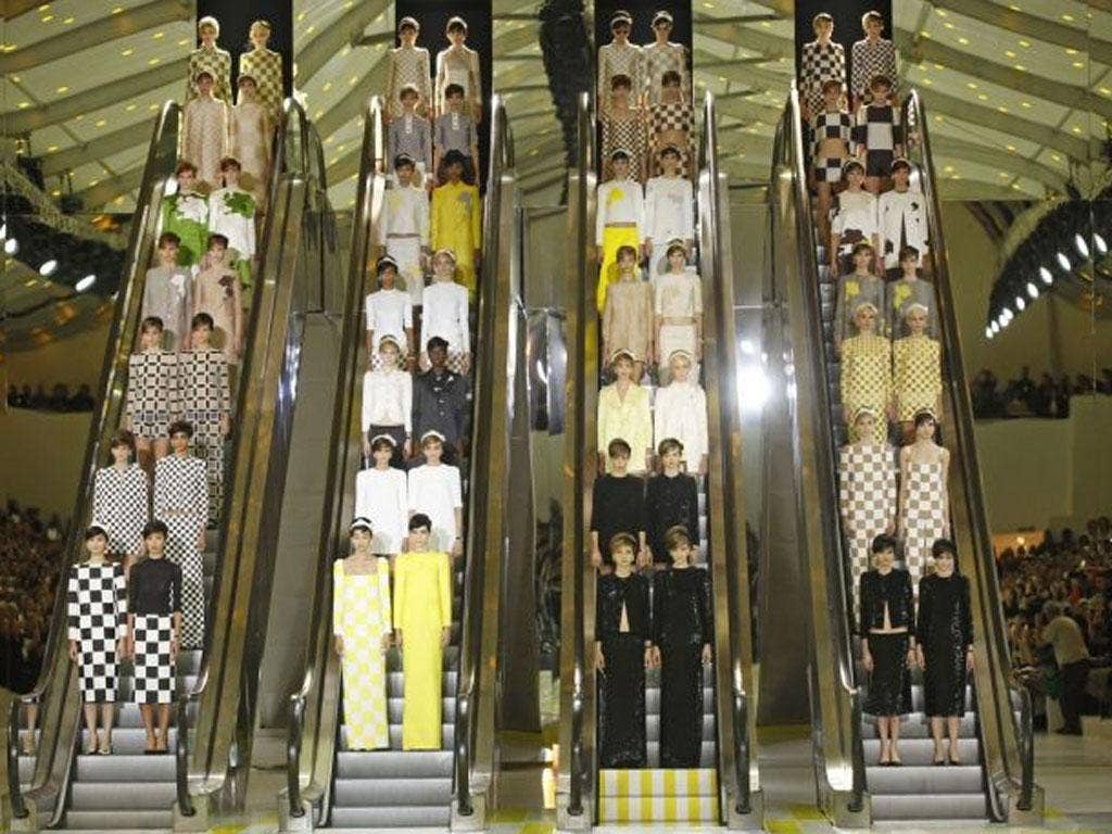 Louis Vuitton Spring/Summer 2013 show included a prosaic mode of transport as the models came down to the catwalk via escalators