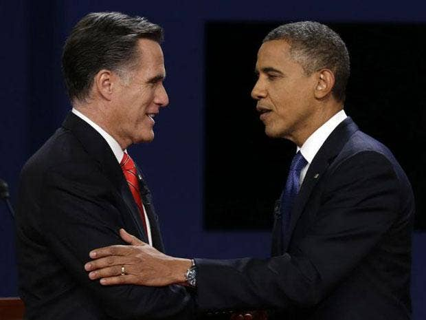 Mitt Romney and Barack Obama shake hands after the first presidential debate at the University of Denver