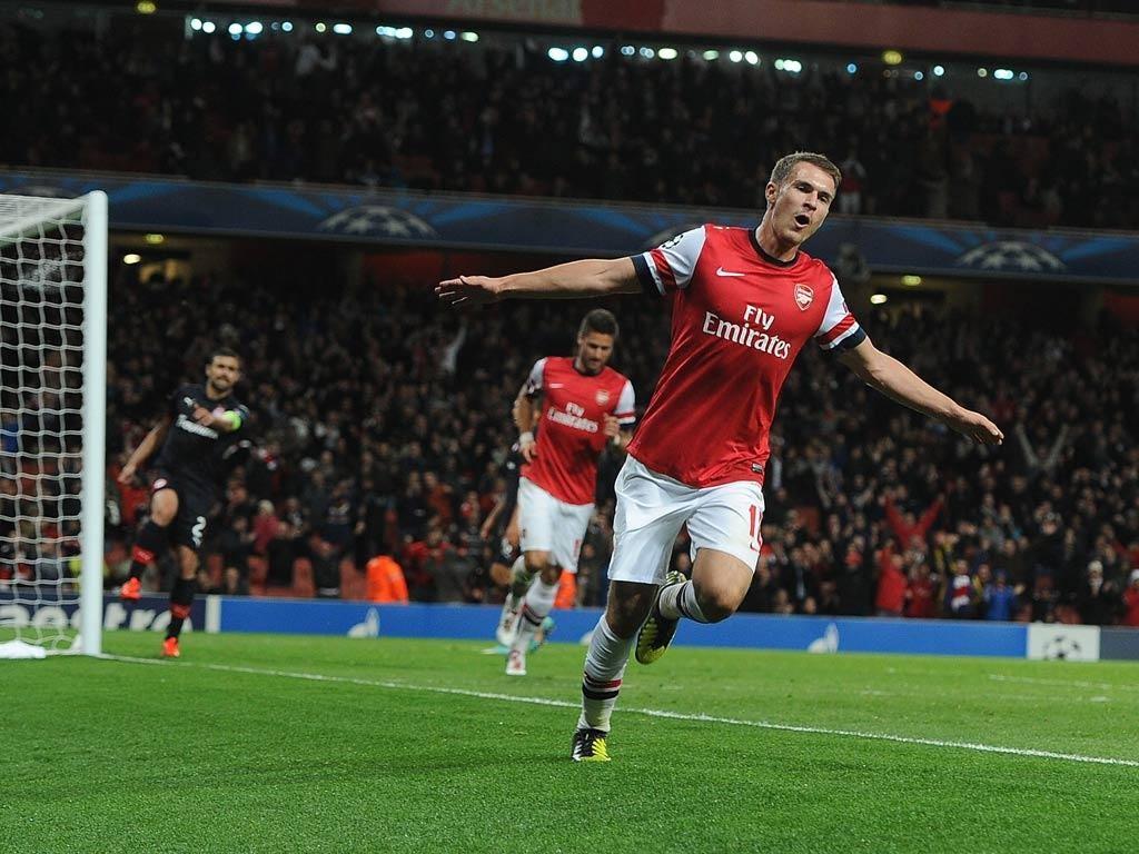 Aaron Ramsey celebrates his Champions League goal against Olympiakos