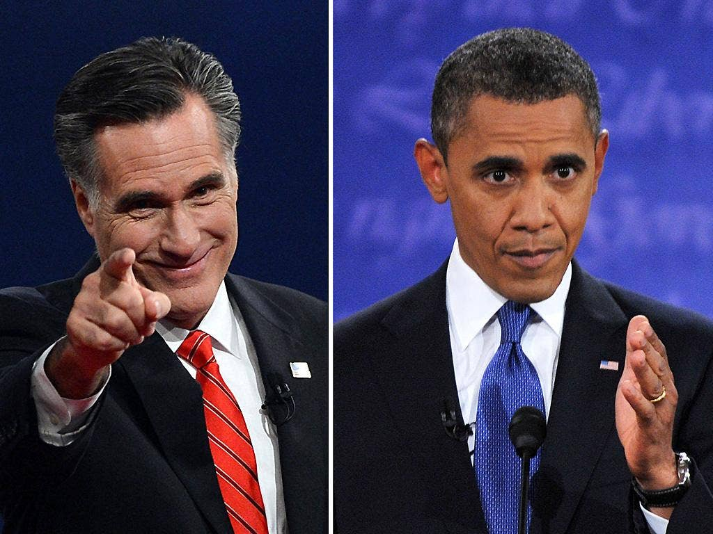 Mitt Romney and Barack Obama at the conclusion of the debate in Denver, Colorado