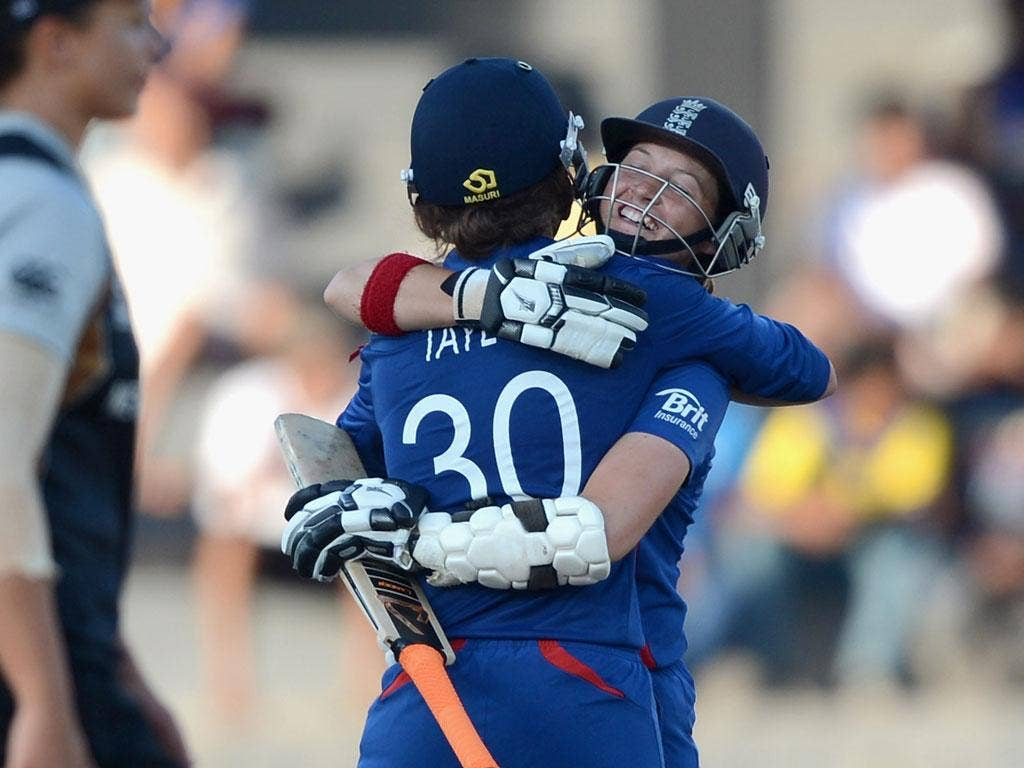 Sarah Taylor and Arran Brindle celebrate their win over New Zealand