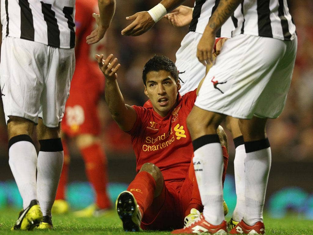 Luis Suarez scored soon after coming on but could not rescue Liverpool last night
